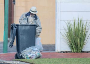 Criminal elements mingle with real bin pickers, such as this elderly man.