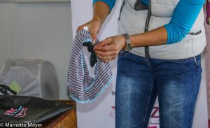 Liza Adlem demonstrates how the pad locks onto the panty.