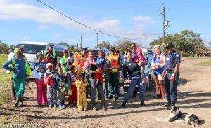 "Constable Debbie Alard with kid in pink, ""Mandela's Child' left front with cap. Photos: Marnette Meyer"