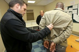 Arrest of detective for corruption at Milnerton Police Station. Photo: SAPS