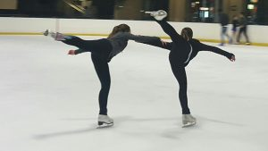 Mia and Nikita 'fly' over the ice.