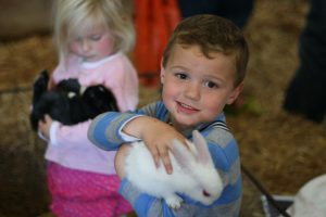 Hugging bunnies at the Mega Touch Farm.