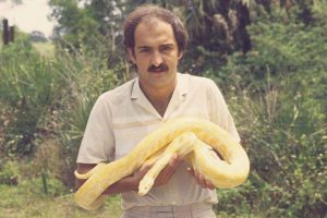 An old photo of Johan Marais. It shows him handling a albinio Burmese python. Photo: African Snakebite Institute