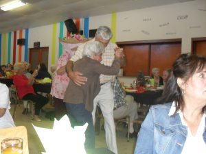 Mabel dances with her son Niel. Her daughter Emmerencia is on the right.