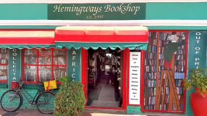 The bold red and green exterior of Hemingways Bookshop.
