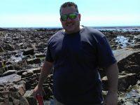 Werner Strydom on the rocks in front of Castella Amare. Photos: Melkbos.net