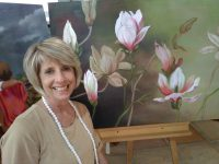Celeste Vorster with her painting of magnolias. Photos: Melkbos.net